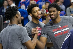 Dec 11, 2015; Philadelphia, PA, USA; Philadelphia 76ers center Joel Embiid (R) and center Jahlil Okafor (M) greet Detroit Pistons forward Stanley Johnson (L) prior to game action at Wells Fargo Center. Mandatory Credit: Bill Streicher-USA TODAY Sports